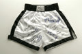 Boxing Collectibles:Autographs, Boxing Greats Everlast Trunks Signed by 21. Pair of white Everlasttrunks with black trim have been signed on the front by ...