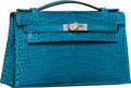 Luxury Accessories:Bags, Hermes Shiny Blue Izmir Alligator Kelly Pochette Bag with PalladiumHardware. R Square, 2014. Pristine Condition....