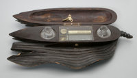 "Mary Todd Lincoln's Desktop Music Box, Incorporating an Ink Well 15"" in length, elaborately carved from walnut in t..."