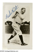 """Autographs:Celebrities, George Herman """"Babe"""" Ruth Signed Photograph. Black and white photograph of the Babe in action; this photo shows Ruth swingi..."""