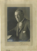 "Autographs:U.S. Presidents, Woodrow Wilson Signed Photograph. Here we have a 9.5"" x 13, blackand white photograph of Wilson on which he signs himself, ..."
