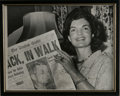 """Autographs:Celebrities, Jacqueline Kennedy Photograph Signed. 10.5"""" x 8.5"""", 1960. A young,smiling Jackie glances up from the July 11 edition of th..."""