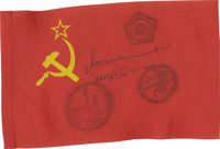 Two Space Flown and Signed Flags Flown into space during the joint efforts of Soyuz TM-2 and Soyuz 39, respectively, are...