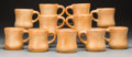 Ceramics & Porcelain, American:Contemporary   (1950 to present)  , Harding Black (American, 1912-2004). Eleven Mugs, 1972. Tan glazed stoneware. 4 inches high (10.2 cm). All are signed an... (Total: 11 Items)