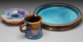 Ceramics & Porcelain, Harding Black (American, 1912-2004). Two Trays and a Mug, 1964, 1969 & 1981. Flambé glazed stoneware. 11 inches diameter... (Total: 3 Items)