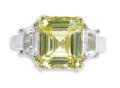 Estate Jewelry:Rings, Yellow Sapphire, Diamond, Gold Ring. The ring centers an emerald cut yellow sapphire measuring 10.75 x 9.35 x 6.25 mm and ...
