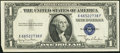 Error Notes:Attached Tabs, Fr. 1613W $1 1935D Wide Silver Certificate. About Uncirculated.....