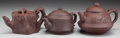 Other, Three Chinese Yixing Pottery Teapots, 20th century. Marks: (character marks to undersides of lids and bodies) . 4-1/2 inches... (Total: 3 Items)