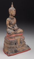 , A Thai Painted Bronze Figure of Seated Buddha, late 18th century. 10-1/2 inches high (26.7 cm). ...