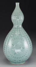 Asian:Other, A Korean Celadon Glazed Porcelain Double Gourd Vase. Marks:(character marks to underside). 16-1/2 inches high (41.9 cm). ...