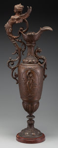 Decorative Arts, French, A Rococo-Style Bronzed Metal Figural Ewer on Rouge Marble Base,late 19th century. 25 inches high (63.5 cm). ...