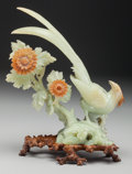 Asian:Chinese, A Chinese Carved Serpentine Phoenix and Flowers on Stand, 20thcentury. 12-3/4 inches high x 10 inches wide (32.4 x 25.4 cm)...
