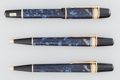 Decorative Arts, Continental, A Three-Piece Writers Edition Montblanc Edgar Allan PoeMarbled Resin, Gilt Silver and 18K Gold Writing Set, cir... (Total:3 Items)