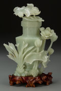 Asian:Chinese, A Chinese Carved Jade Lotus Motif Covered Vase with Stand. 9-1/2inches high (24.1 cm) (without stand). ...