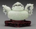 Asian:Chinese, A Chinese Carved Celadon Jade Teapot on Stand. 4-1/4 h x 7-1/8 winches (10.8 x 18.1 cm) (excluding base) . ...