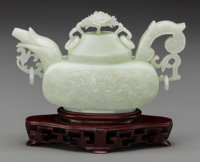 A Chinese Carved Celadon Jade Teapot on Stand 4-1/4 h x 7-1/8 w inches (10.8 x 18.1 cm) (excluding base)