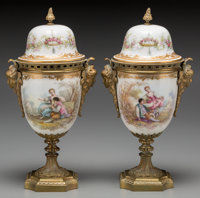 A Pair of Sèvres-Style Porcelain Covered Urns with Gilt Metal Mounts, early 20th century Marks to lid: (spurious...