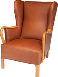 Furniture : Continental, A Danish Leather Upholstered Birch Armchair, circa 1940. 38 h x27-1/2 w x 33 d inches (96.5 x 69.9 x 83.8 cm). ...