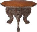Furniture : Continental, A Renaissance Revival Walnut Nine-Sided Center Table, 19th century.30 h x 44 inches d (76.2 x 111.8 cm). ...