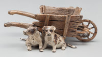 An Austrian Cold Painted Bronze Figural Group: Puppies with Wheelbarrow, late 19th c
