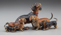 Sculpture, An Austrian Cold Painted Figural Group: Dachshund Family, late 19th century. 5 inches long (12.7 cm). ...