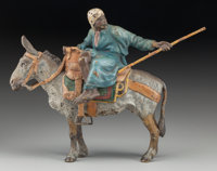 An Austrian Cold Painted Bronze Figural Group: Moorish Man Riding a Donkey, cast by