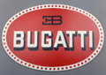 Decorative Arts, French, A Painted Wood Oval Bugatti Trade Sign, 20th century. 22 incheshigh x 33-1/8 inches wide (55.9 x 84.1 cm). ...