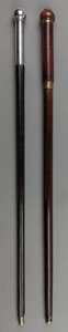 Decorative Arts, British:Other , Two Canes with Chambers: Shaving Kit and Bow & Arrow,early 20th century. 36-3/4 inches high (93.3 cm). ... (Total: 2Items)