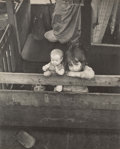 Photographs, Juliette Lasserre (British, 20th century). Two Girls with DollBehind Wooden Fence, circa 1934. Gelatin silver. 11-1/4 x...