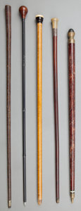 Decorative Arts, American, Five Various Canes Including Pool Cue, Lighter, Spear, early 20th century. 37-3/4 inches high (95.9 cm) (tallest). ... (Total: 5 Items)