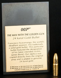 "The Man with the Golden Gun (Danjaq Inc., 1995). Prop Bullet Replica (1.5"" X .25"" X .25"") with Plaque (3&..."
