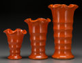 Ceramics & Porcelain, British:Modern  (1900 1949)  , A Set of Three Matt Cartlon Art Deco Orange Glazed Ceramic Vasesfor Bauer Pottery, circa 1930. 11 inches high (27.9 cm) (la...(Total: 3 Items)