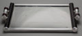 Decorative Arts, British:Other , An English Art Deco Chromed Metal and Ebonized Wood Mirrored Tray,circa 1930. 19 inches long (48.3 cm). PROPERTY FROM THE...