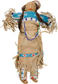 American Indian Art:Kachina Dolls, Beaded Hide Child's Doll....