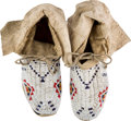 American Indian Art:Beadwork and Quillwork, Pair Woman's Beaded Buffalo Hide Moccasins....