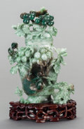 Asian:Chinese, A Chinese Carved Jade Covered Koro with Stand, late 19th century.9-1/8 h x 5-1/2 w x 3-1/4 d inches (23.2 x 14.0 x 8.3 cm)...