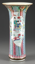 Asian:Chinese, A Chinese Famille Rose Porcelain Ribbed Beaker-Form Vase . 16inches high (40.6 cm). PROPERTY FROM THE ESTATE OF FRED D. W...