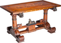 An Egyptian Revival Mahogany and Marquetry Library Table, circa 1870 30-3/4 h x 55 w x 30-3/4 d inches (78.1 x 139