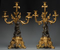 Decorative Arts, French:Lamps & Lighting, A Pair of Gilt and Patinated Bronze Three-Light Figural Candelabra,late 19th/early 20th century. 27-1/2 inches high x 16 in... (Total:2 Items)