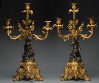 A Pair of Gilt and Patinated Bronze Three-Light Figural Candelabra, late 19th/early 20th century 27-1/2 inches hig