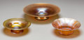 Art Glass:Tiffany , Three Tiffany Studios Gold Favrile Glass Bowls, Corona, New York, circa 1915. Marks to largest: L.C. Tiffany - Favrile, 94... (Total: 3 Items)