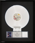 Music Memorabilia:Awards, Prince and the Revolution Purple Rain RIAA Platinum RecordSales Award (Warner Bros. 1-25110, 1984). ...