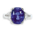 Estate Jewelry:Rings, Sapphire, Diamond, White Gold Ring. The ring centers acushion-shaped sapphire measuring 11.65 x 9.10 x 6.65 mm andweighi...