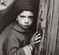 Photographs, Tibor Honty (Czech, 1907-1968). Small boy at doorway, circa1960. Gelatin silver. 7 x 7-1/2 inches (17.8 x 19.1 cm). The...