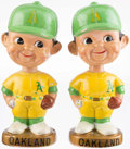 Baseball Collectibles:Others, 1967-72 Oakland Athletics Gold Base Nodders Lot of 2....