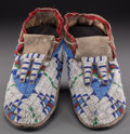 American Indian Art:Beadwork and Quillwork, A Pair of Sioux Beaded Hide Moccasins . c. 1890 ... (Total: 2Items)