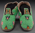 American Indian Art:Beadwork and Quillwork, A Pair of Cheyenne Pictorial Beaded Hide Moccasins ... (Total: 2Items)