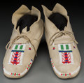 American Indian Art:Beadwork and Quillwork, A Pair of Cheyenne Beaded Hide Moccasins... (Total: 2 Items)