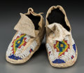 American Indian Art:Beadwork and Quillwork, A Pair of Sioux Child's Beaded Hide Moccasins... (Total: 2 Items)