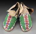 American Indian Art:Beadwork and Quillwork, A Pair of Sioux Beaded Hide Moccasins. c. 1885... (Total: 2 Items)